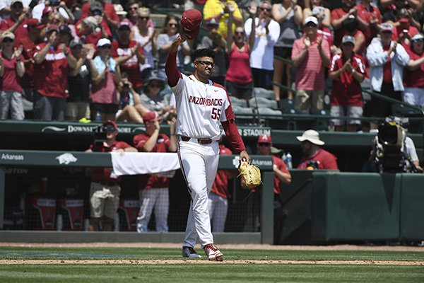 Arkansas pitcher Isaiah Campbell waves to the fans after heading to the dugout in the ninth inning against Ole Miss in Game 1 of the NCAA Fayetteville Super Regional on Saturday, June 8, 2019, in Fayetteville. (AP Photo/Michael Woods)