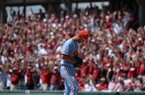 Ole Miss starter Will Ethridge waits atop the mound Saturday, June 8, 2019, as Arkansas fans call the Hogs after Ethridge gave up a three-run home run to Arkansas second baseman Jack Kinley during the first inning in the NCAA Super Regional game at Baum-Walker Stadium in Fayetteville.