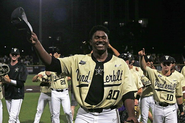 Vanderbilt's Kumar Rocker (80) tips his hat to fans after the team's NCAA college baseball tournament super regional game against Duke on Saturday, June 8, 2019, in Nashville, Tenn. Rocker threw a no-hitter in Vanderbilt's 3-0 victory. (AP Photo/Wade Payne)