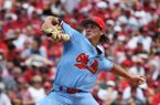 Mississippi pitcher Doug Nikhazy throws a pitch against Arkansas during the first inning of Game 2 at the NCAA college baseball super regional tournament Sunday, June 9, 2019, in Fayetteville, Ark. (AP Photo/Michael Woods)