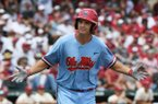 Mississippi batter Cole Zabowski reacts after hitting a three-run home run against Arkansas during the first inning of Game 2 at the NCAA college baseball super regional tournament Sunday, June 9, 2019, in Fayetteville, Ark. (AP Photo/Michael Woods)