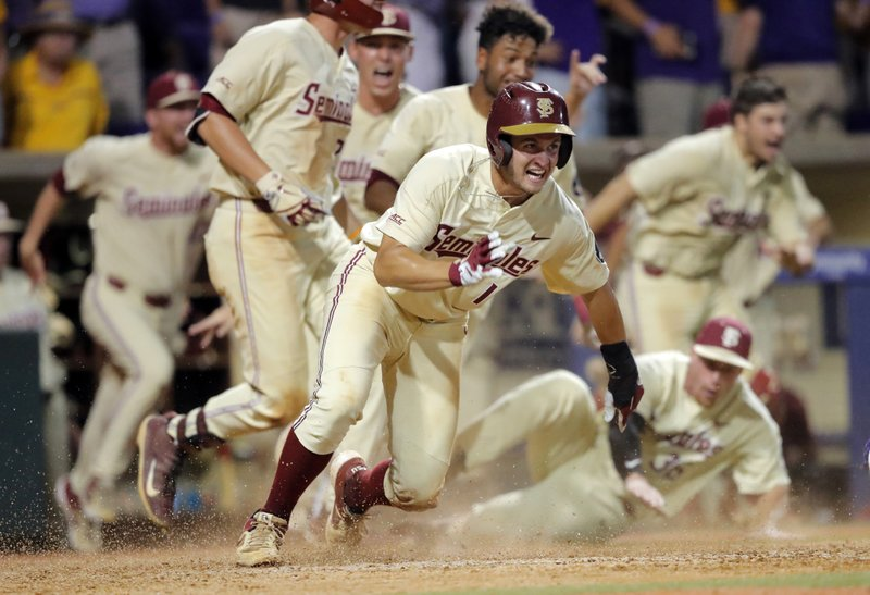 online store e6f85 9d28b Florida State s Mike Salvatore reacts after crossing home plate to score  the winning run against LSU in the 12th inning of Game 2 of the NCAA  college ...