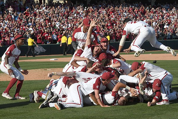 Arkansas players celebrate after defeating Ole Miss 14-1 in Game 3 of the NCAA Fayetteville Super Regional at Baum-Walker Stadium on Monday, June 10, 2019, in Fayetteville.