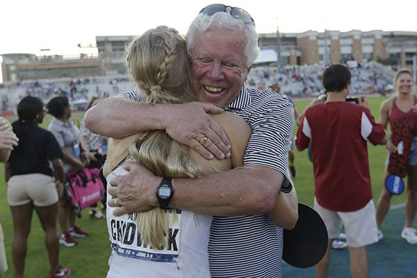 Arkansas' Payton Chadwick is hugged by coach Lance Harter, right, after the team won the women's NCAA outdoor track and field championships in Austin, Texas, Saturday, June 8, 2019. (AP Photo/Eric Gay)