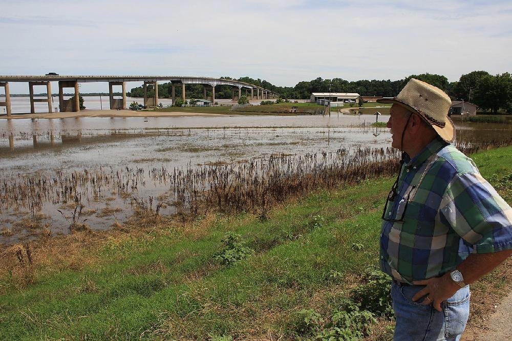 Glendon Lambert of Pendleton looks toward his town in Desha County as the Arkansas River begins to recede and reveal some of the heavy damage inflicted there. Lambert, who owns a motel and some rental property, said sandbagging didn't help against the record flooding.