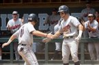 Auburn's Edouard Julien (10) celebrates with Judd Ward (1) after scoring a run during the first inning of an NCAA super regional baseball game against North Carolina in Chapel Hill, N.C., Monday, June 10, 2019. (AP Photo/Ben McKeown)