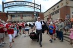 Arkansas coach Dave Van Horn walks out of Baum-Walker Stadium on Wednesday, June 12, 2019, in Fayetteville. Van Horn was boarding a bus bound for Northwest Arkansas Regional Airport, where the Razorbacks were to catch a flight to Omaha, Neb., for the 2019 College World Series that begins Saturday.