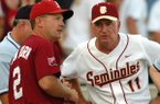 Arkansas coach Dave Van Horn (left) and Florida State coach Mike Martin speak prior to an NCAA super regional game on Saturday, June 12, 2004, in Fayetteville. Martin and Van Horn lead active college baseball coaches in appearances at the College World Series, but this weekend's game will be their first against one another in Omaha.