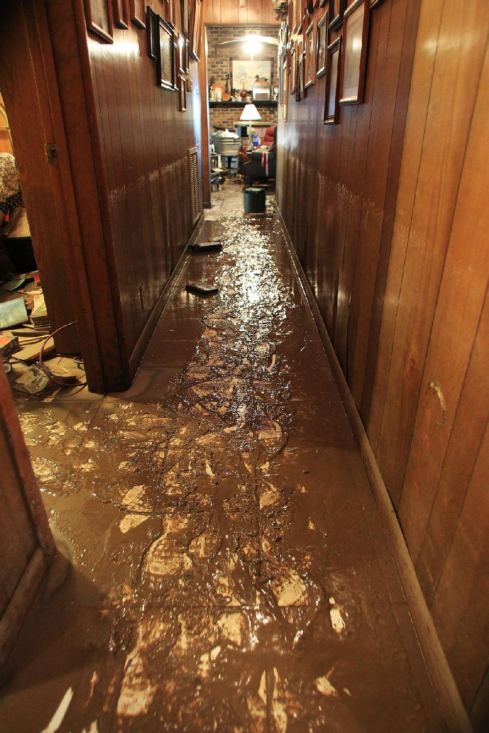 """Mud covers a hallway of Phyllis Crow's home on Ray Dean Road in Tucker on Wednesday. The flooding dumped nearly 2 feet of water in the house. """"We didn't think the water was going to get this high,"""" she said. """"And then it did."""""""