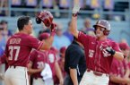 Florida State's Mike Salvatore (16) and Tim Becker (37) celebrate after they scored on Reese Albert's tying three-run home run against LSU in the seventh inning of Game 1 of the NCAA college baseball super regional tournament in Baton Rouge, La., Saturday, June 8, 2019. (AP Photo/Gerald Herbert)