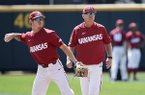 Arkansas NCAA college baseball coach Dave Van Horn, right, follows team practice at TD Ameritrade Park, as Casey Martin throws in Omaha, Neb., Friday, June 14, 2019. Arkansas opens College World Series play Saturday night against Florida State, which will be trying to win retiring coach and NCAA all-time wins leader Mike Martin's first national championship in his 17 visits to Omaha. (AP Photo/Nati Harnik)