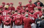 Arkansas NCAA college baseball coach Dave Van Horn, center, addresses his players following practice at TD Ameritrade Park in Omaha, Neb., Friday, June 14, 2019. Arkansas opens College World Series play Saturday night against Florida State, which will be trying to win retiring coach and NCAA all-time wins leader Mike Martin's first national championship in his 17 visits to Omaha. (AP Photo/Nati Harnik)