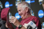 Florida State NCAA college baseball coach Mike Martin removes his cap at the start of a news conference at TD Ameritrade Park in Omaha, Neb., Friday, June 14, 2019. Florida State will be trying to win retiring coach and NCAA all-time wins leader Martin's first national championship in his 17 visits to Omaha, is playing Arkansas on Saturday in the College World Series. (AP Photo/Nati Harnik)