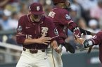 Florida State pitcher CJ Van Eyk (15) celebrates with center fielder C.J. Flowers (8) after Flowers scored to go-ahead run during the ninth inning o a College World Series game against Arkansas on Saturday, June 15, 2019, at TD Ameritrade Park in Omaha, Neb.
