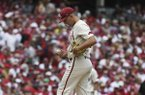 Arkansas pitcher Connor Noland tries to re-group after giving up a three-run home run against Ole Miss during the first inning of Game 2 of an NCAA college baseball super regional Sunday, June 9, 2019, in Fayetteville. (AP Photo/Michael Woods)