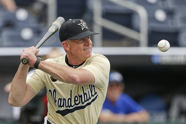 Vanderbilt NCAA college baseball coach Tim Corbin hits ground balls during team practice at TD Ameritrade Park in Omaha, Neb., Friday, June 14, 2019. Vanderbilt plays against Louisville on Sunday in the College World Series. (AP Photo/Nati Harnik)