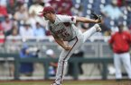 Arkansas pitcher Kevin Kopps throws during a College World Series game against Texas Tech on Monday, June 17, 2019, in Omaha, Neb.