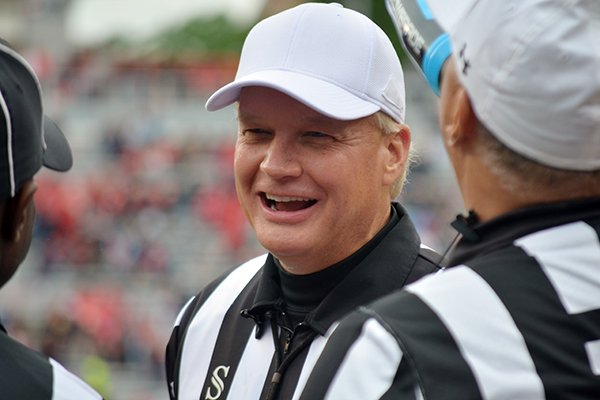 In this April 20, 2019, photo, Steve Shaw talks with a colleagues during Georgia's spring NCAA college football game in Athens, Ga. Officials are graded weekly on every play and those grades ultimately determine what conference they work. SEC officials have often worked their way up from the Sun Belt. Bowl assignments are determined by regular-season grades and poor grades can lead to demotions. Shaw, the national coordinator of football officials and the SEC s head of officiating, said last week at the conference spring meetings that eight officials won t be returning to the SEC this season. One moved on to the NFL and seven either retired or were not retained, Shaw said, declining to elaborate. (Gary McGriff via AP)
