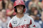 Arkansas' Casey Martin (15) reacts after striking out against Texas Tech in the ninth inning of an NCAA College World Series baseball game in Omaha, Neb., Monday, June 17, 2019. Texas Tech won 5-4. (AP Photo/Nati Harnik)