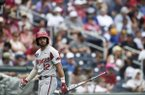 Arkansas catcher Casey Opitz walks toward the dugout during a College World Series game against Texas Tech on Monday, June 17, 2019, in Omaha, Neb.