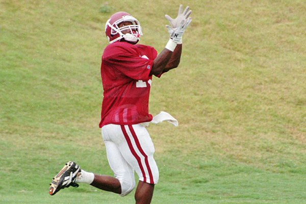 Arkansas receiver Shannon Sidney prepares to catch a pass during practice Tuesday, Sept. 19, 1995, in Fayetteville.