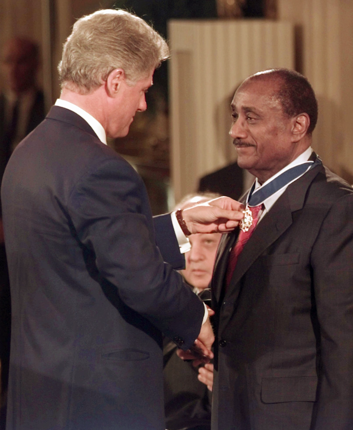 John H. Johnson (right), chief executive officer of Johnson Publishing, received a Presidential Medal of Freedom from President Bill Clinton in 1996. (AP)
