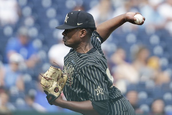 Vanderbilt pitcher Kumar Rocker (80) works against Mississippi State in the seventh inning of an NCAA College World Series baseball game in Omaha, Neb., Wednesday, June 19, 2019. (AP Photo/Nati Harnik)