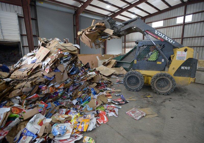 Solid waste district hires trash hauler