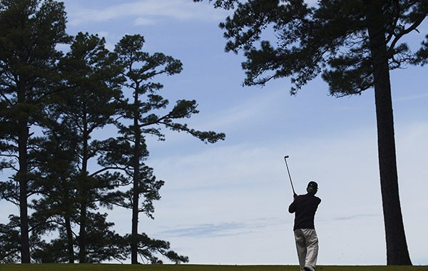 A golfer plays at War Memorial Golf Course on Thursday, April 21, 2016, in Little Rock. The course made famous by its tailgating during Razorbacks football games is set to close.