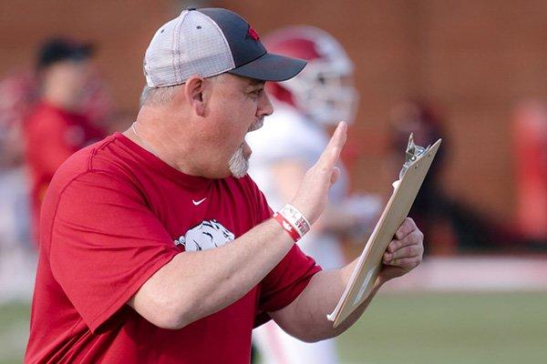 Shaun Mercer, 47, is a volunteer assistant coach at Arkansas after giving up a six-figure job.