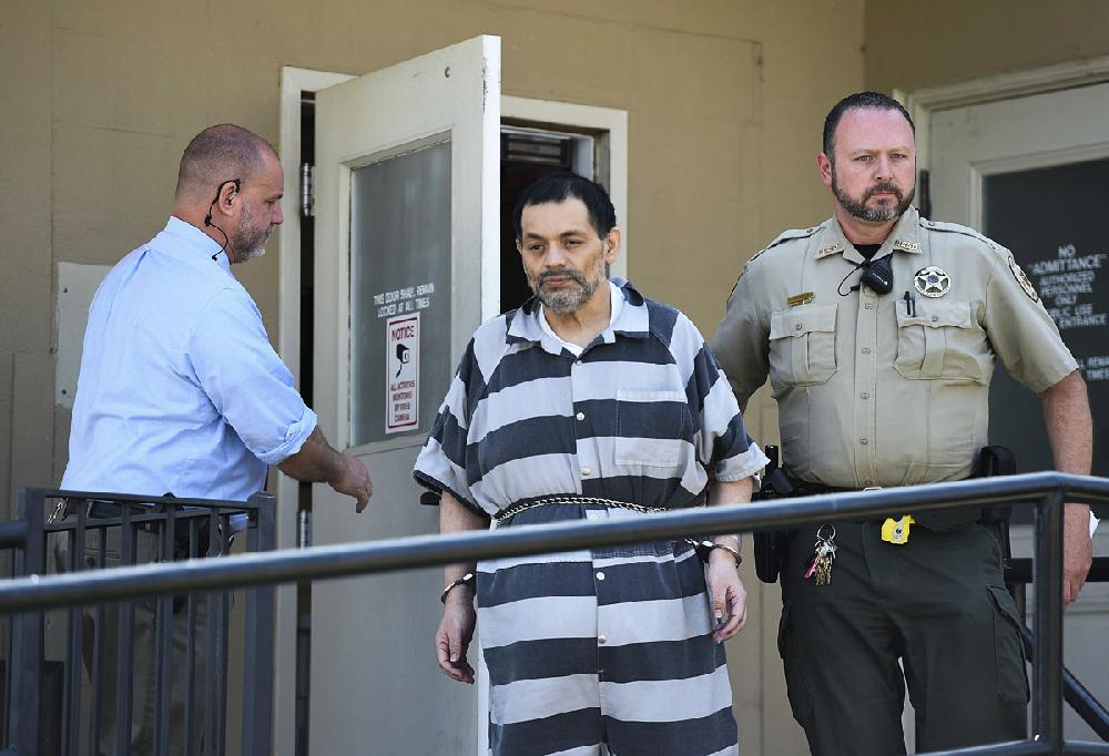 'Tired' dad back in court faces retrial in boy's death