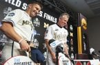 Michigan coach Erik Bakich and Vanderbilt coach Tim Corbin share a laugh during a news conference Sunday, June 23, 2019, in Omaha, Neb. When Michigan (49-20) opens the best-of-three CWS finals against No. 2 national seed Vanderbilt (57-11) on Monday night, it will be playing its ninth game at TD Ameritrade in 34 days. (Z Long/Omaha World-Herald via AP)