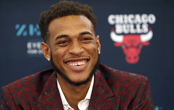 Chicago Bulls second-round pick, Arkansas power forward Daniel Gafford, laughs during an NBA basketball news conference Monday, June 24, 2019, in Chicago. (AP Photo/Charles Rex Arbogast)