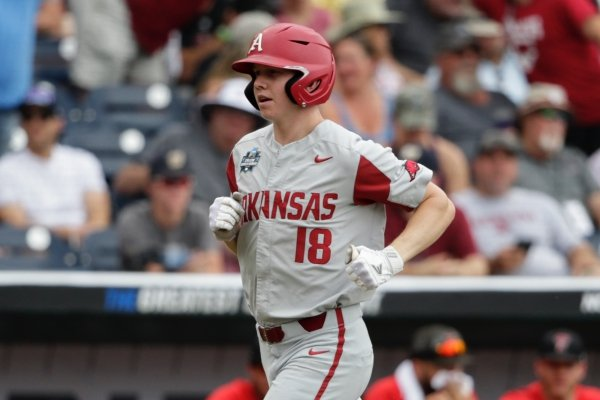 Arkansas' Heston Kjerstad (18) runs the bases after hitting a solo home run against Texas Tech in the second inning of an NCAA College World Series baseball game in Omaha, Neb., Monday, June 17, 2019. (AP Photo/Nati Harnik)