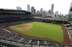 The roof of Minute Maid ballpark is open showing a portion of the Houston downtown skyline during an exhibition baseball game between the Houston Astros and the Kansas City Royals Saturday, April 4, 2015, in Houston. (AP Photo/Pat Sullivan)