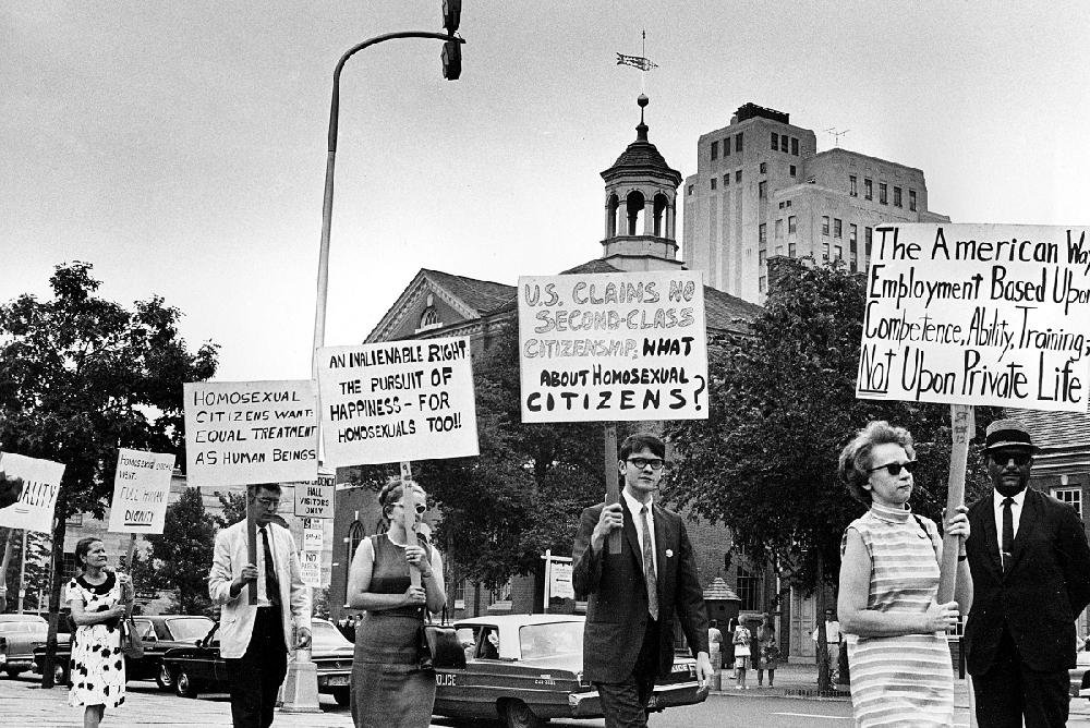 In this July 4, 1967, file photo, Kay Tobin Lahusen (right) and other demonstrators carry signs calling for protection of homosexuals from discrimination as they march in a picket line in front of Independence Hall in Philadelphia. Two years later, the movement came to a head at the Stonewall Inn in New York.