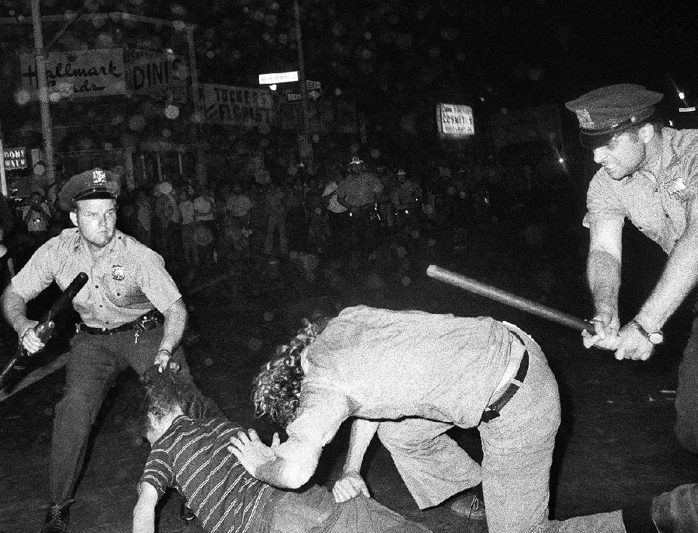 In this Aug. 31, 1970, photo, a New York Police Department officer grabs a man by the hair as another officer clubs a young man during a confrontation in Greenwich Village after a Gay Power march in New York. A year earlier, the June 1969 uprising by young gay men, lesbians and transgender people at a bar called the Stonewall Inn was a vital catalyst in expanding LGBT activism nationwide and abroad.