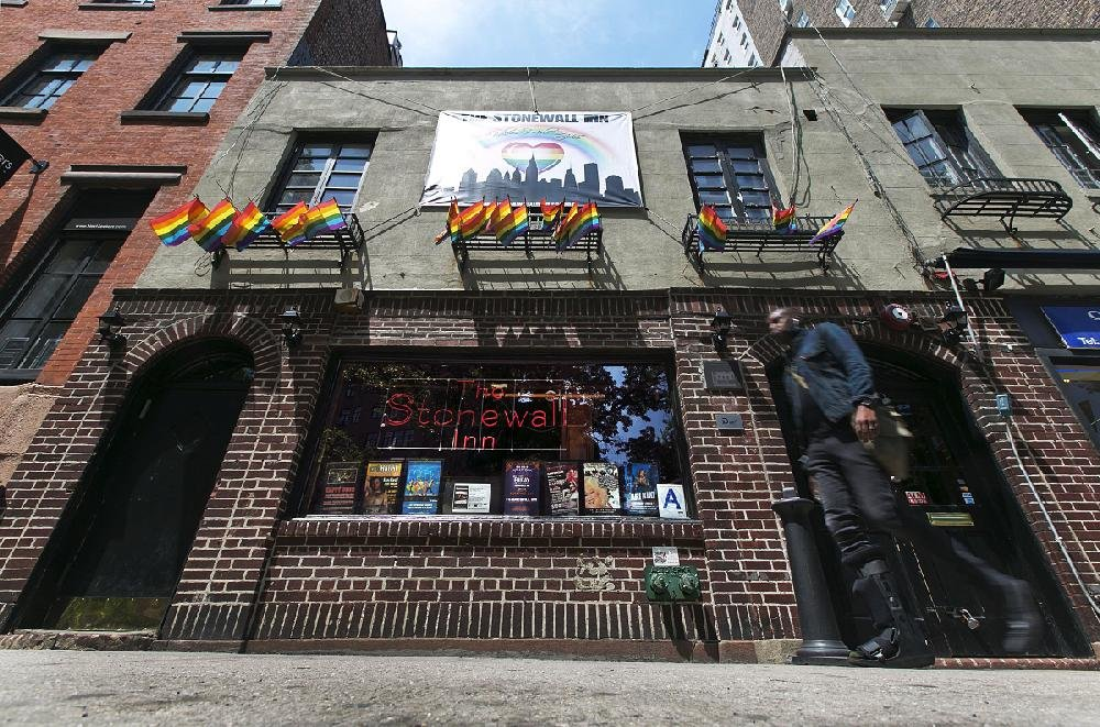 In this May 29, 2014, file photo, a man passes The Stonewall Inn in New York's Greenwich Village. The bar was the site of the Stonewall uprising that started on June 28, 1969, and galvanized the gay rights movement.