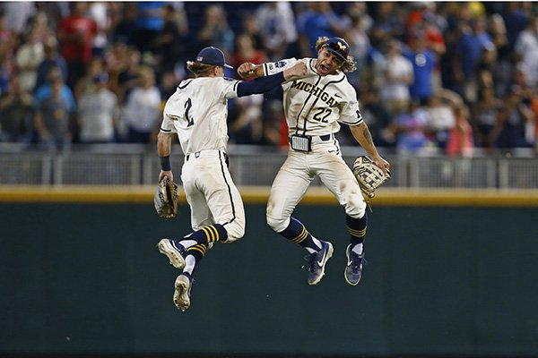 Michigan right fielder Jordan Brewer (22) celebrates with Michigan shortstop Jack Blomgren (2) after Michigan defeated Vanderbilt in Game 1 of the NCAA College World Series baseball finals in Omaha, Neb., Monday, June 24, 2019. (AP Photo/John Peterson)