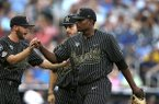 Vanderbilt pitcher Kumar Rocker walks off the mound after retiring the side against Michigan in the first inning of Game 2 of the NCAA College World Series baseball finals in Omaha, Neb., Tuesday, June 25, 2019. (AP Photo/Nati Harnik)