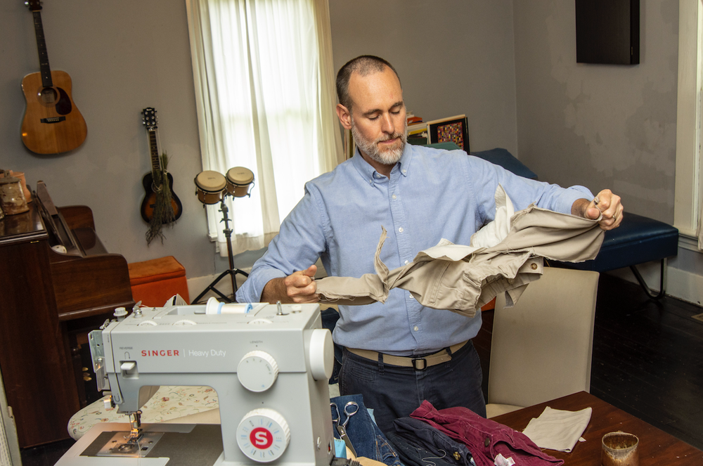 James Matthews prepares clothing for use in his quilts. Matthews' exhibition at the Arts & Science Center for Southeast Arkansas in Pine Bluff continues through Sept. 28. (Arkansas Democrat-Gazette/CARY JENKINS)