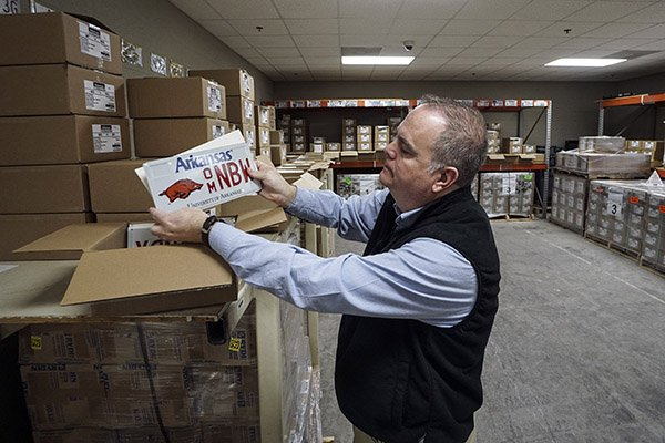 James Payne, Manager of Direct Services, shows one of the more popular plates at the inventory control room of the Department of Finance and Administration on Friday, Feb 8, 2018, in Little Rock.