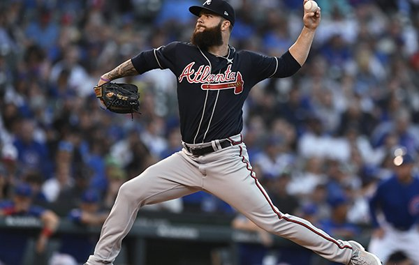 Atlanta Braves starter Dallas Keuchel delivers a pitch during the first inning of the team's baseball game against the Chicago Cubs on Wednesday, June 26, 2019, in Chicago. (AP Photo/Paul Beaty)