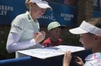 Stacy Lewis (left) signs an autograph for Payton Lindsay, 9, of St. Louis (right) during the first round of the Walmart NW Arkansas Championship, Friday, June 28, 2019, at Pinnacle Country Club in Rogers.