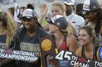 Members of the Arkansas women's track team celebrate after winning the women's team title at the NCAA outdoor track and field championships in Austin, Texas, Saturday, June 8, 2019. (AP Photo/Eric Gay)