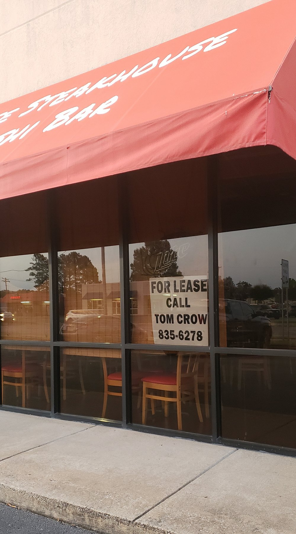 "There's a ""for lease"" sign in the window at Sakura on Kiehl Avenue in Sherwood. Special to the Democrat-Gazette/Michelle Waldo"