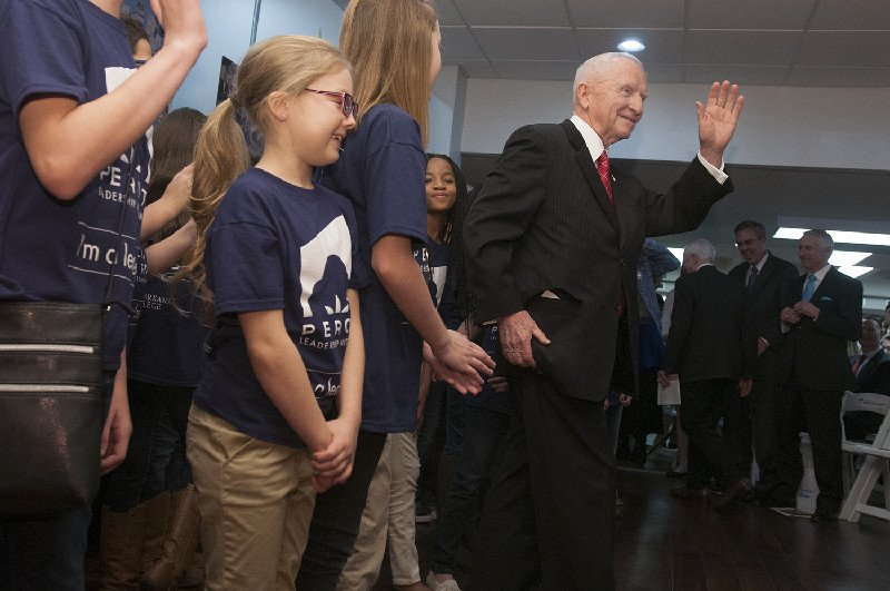 Ross Perot waves to the crowd after Nash Elementary School students performed Friday, Feb. 12, 2016, at the closing of the opening reception of the Perot Leadership Museum at Palmer Memorial Library at Texarkana College.