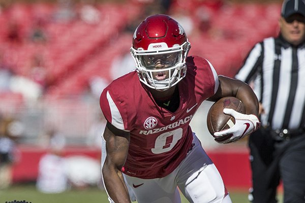 Arkansas receiver Mike Woods runs after catching a pass during a game against Vanderbilt on Saturday, Oct. 27, 2018, in Fayetteville.