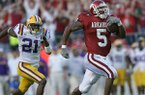 Arkansas running back Darren McFadden runs for an 80-yard touchdown during a game against LSU on Friday, Nov. 24, 2006, in Little Rock. The Razorbacks unveiled throwback uniforms Tuesday that are replicas of those worn by Arkansas from 2005-07.