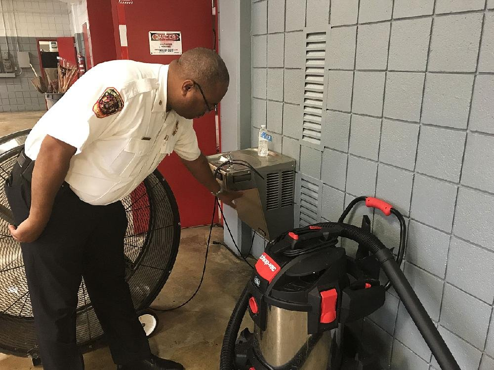 Pine Bluff Fire Chief Shauwn Howell shows how high the water rose into the main fire station during Monday evening's deluge.